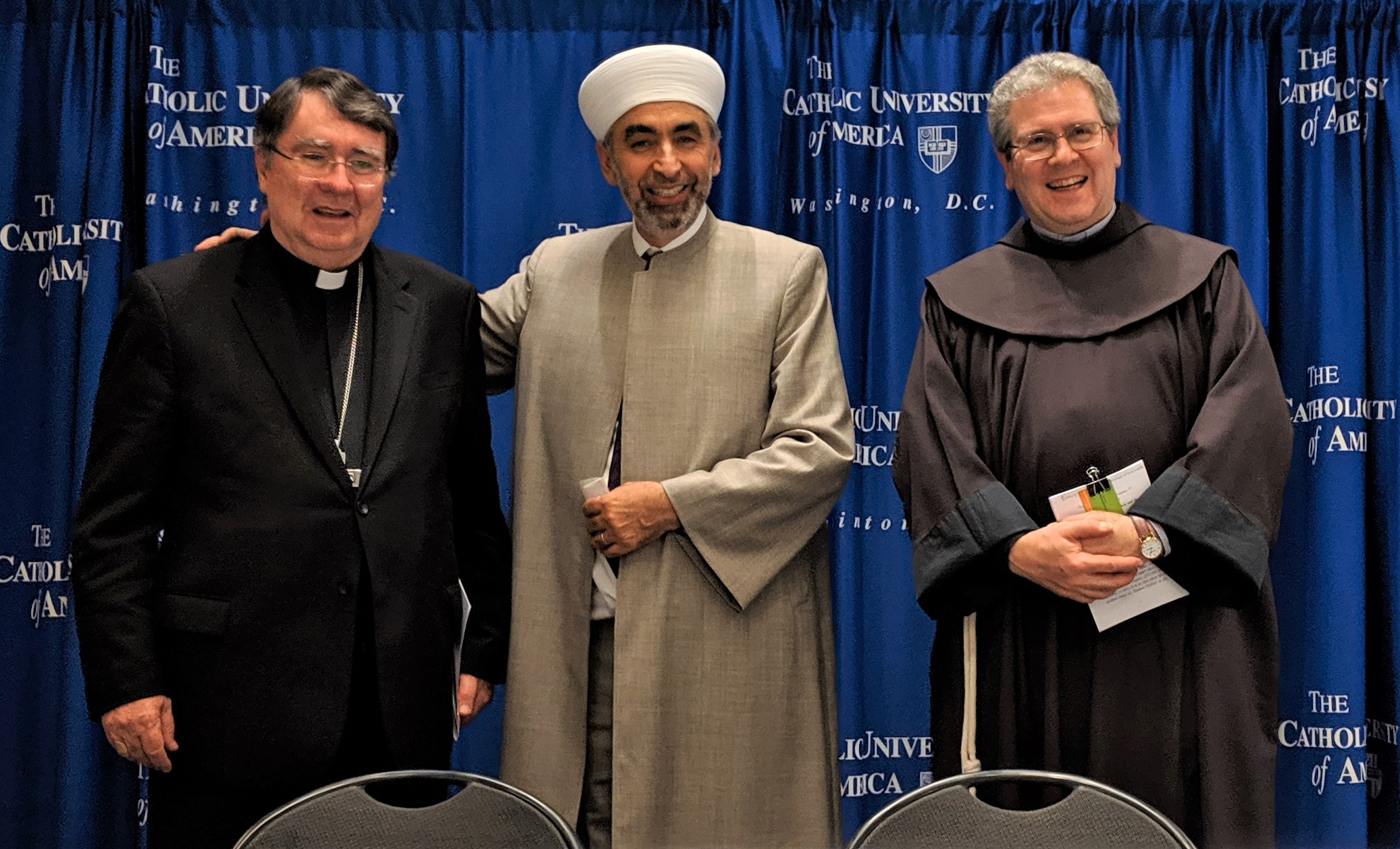 Father Custos (at right) the Apostolic Nuncio to the United States, Archbishop Christophe Pierre (at left) and (in center) Imam Mohamad Bashar Arafat