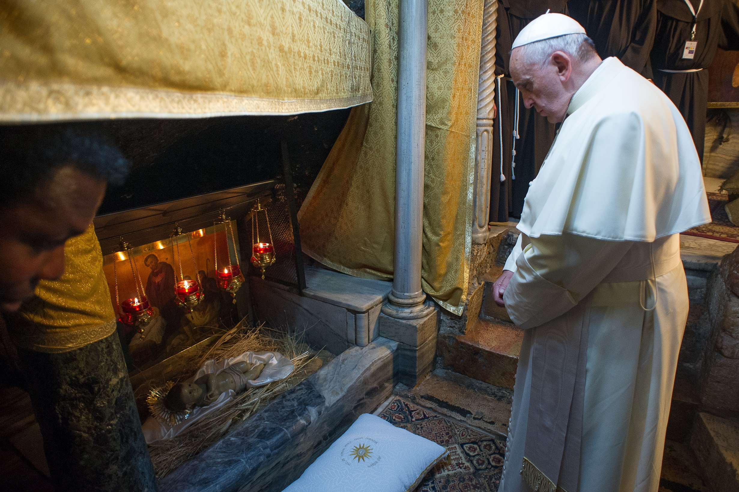 Pope Francis in the Nativity Grotto in Bethlehem, during his pilgrimage to the Holy Land in 2014, © Vatican Media